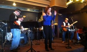 Stu Weissman, DeeAnn Dimeo Tomkins, and Gary Sterlace performed Sunday in Iris restaurant.